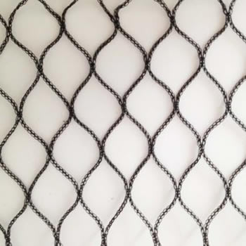 A piece of black diamond knitted bird netting in the white background