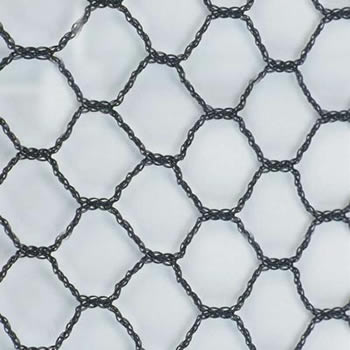 A piece of black hexagonal knitted bird netting in the white background